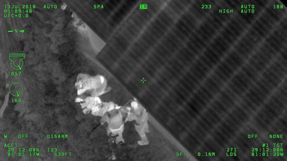 PHOTO: An image released by the Volusia County Sheriffs Office shows officers standing over Matthew White and Amber Taynor during their arrest on July 12, 2018 in Volusia County, Fla.