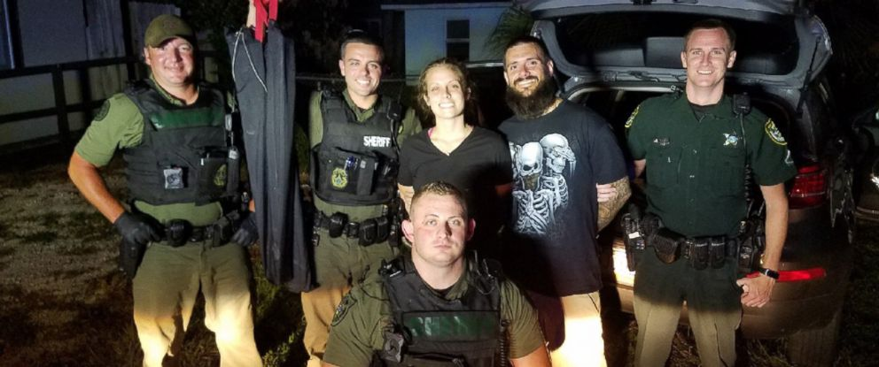 PHOTO: An image released by the Volusia County Sheriffs Office shows officers standing with Matthew White and Amber Taynor after their arrest on July 12, 2018 in Volusia County, Fla.