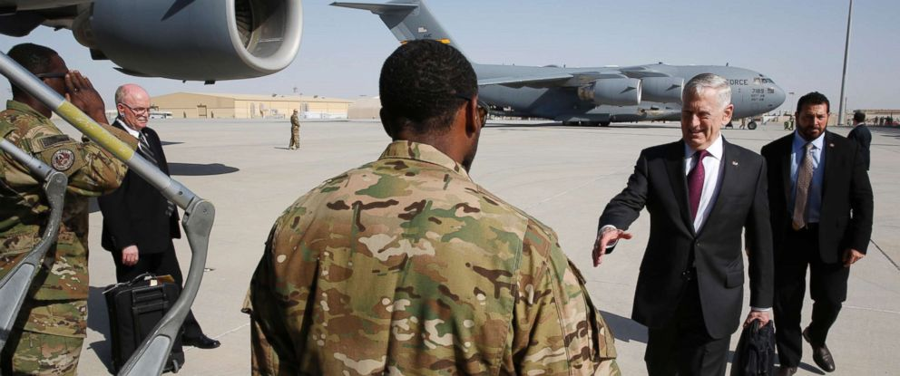 PHOTO: Defense Secretary James Mattis greets an airman as he boards a U.S. Air Force C-17 Globemaster for a day trip to a U.S. military base in Djibouti from Doha, Qatar, April 23, 2017.