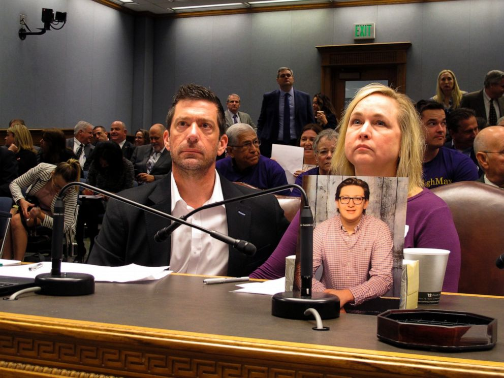 PHOTO: In this March 21, 2018 file photo, Stephen and Rae Ann Gruver sit in a House committee room behind a photo of their son, Maxwell Gruver, a LSU freshman who died with a blood-alcohol content six times higher than the legal limit, in Baton Rouge, La.