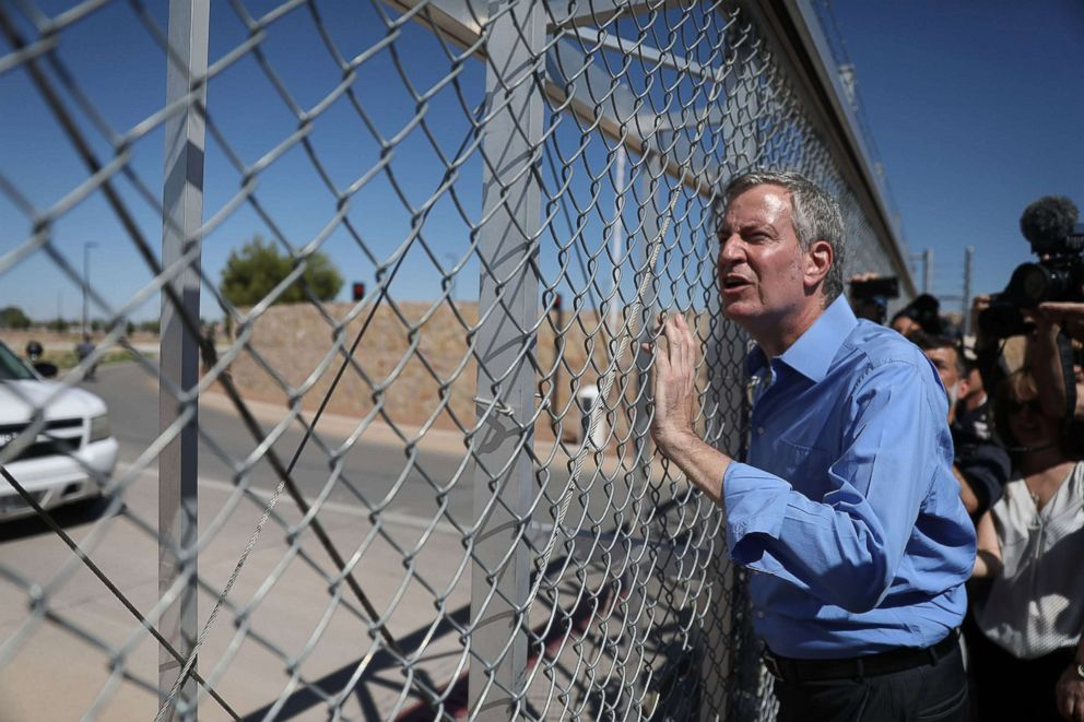 New York City Mayor Bill de Blasio stops at a gate after being told he could not cross through the gate to the tent facility setup at the Tornillo-Guadalupe Port of Entry as he joins with other mayors from the U.S. Conference of Mayors to call for the immediate reunification of separated immigrant families on June 21, 2018 in Fabens, Texas.