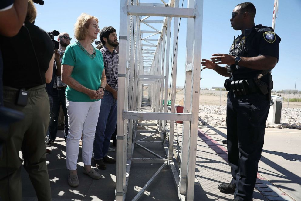 Seattle Mayor Jenny Durkan speaks with a Department of Homeland Security Police officer as she is told she cannot cross through the gate to the tent facility setup at the Tornillo-Guadalupe Port of Entry as she joins with other mayors from the U.S. Conference of Mayors to call for the immediate reunification of separated immigrant families on June 21, 2018 in Fabens, Texas.