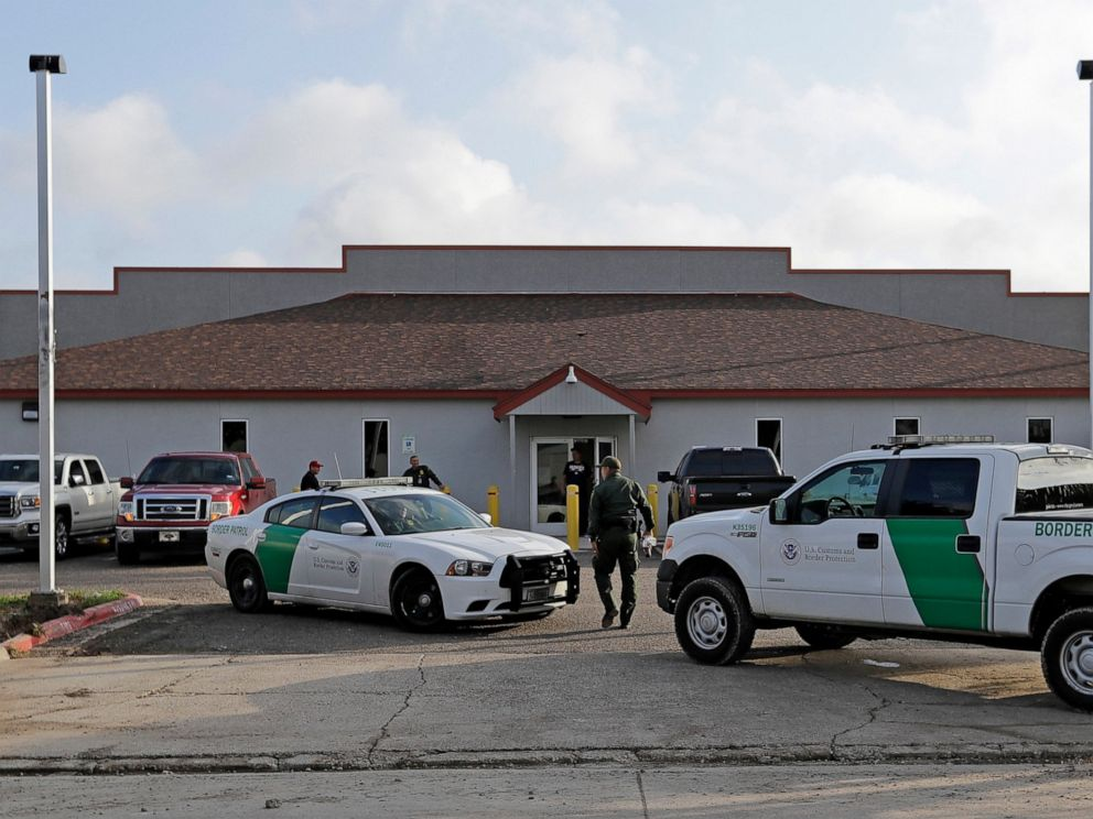PHOTO: In this Saturday, June 23, 2018, file photo, a U.S. Border Patrol Agent walks between vehicles outside the Central Processing Center in McAllen, Texas