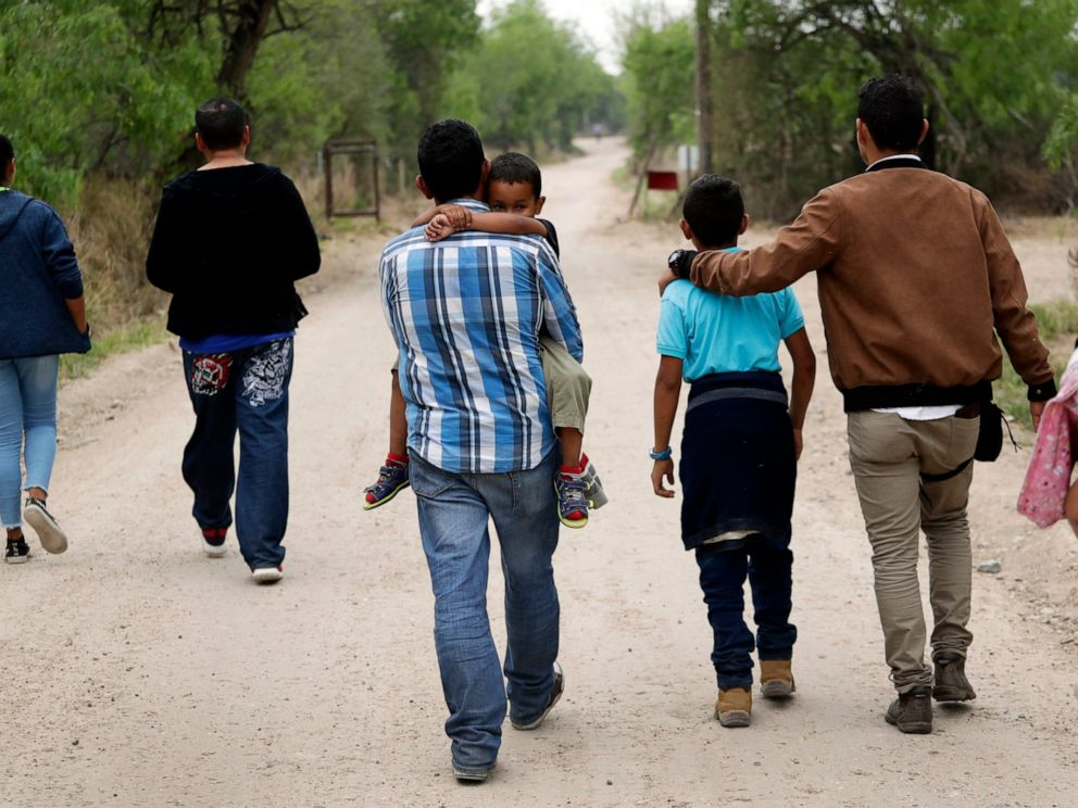 PHOTO: In this March 14, 2019, file photo, a group of migrant families walk from the Rio Grande, the river separating the U.S. and Mexico in Texas, near McAllen, Texas, right before being apprehended by Border Patrol.