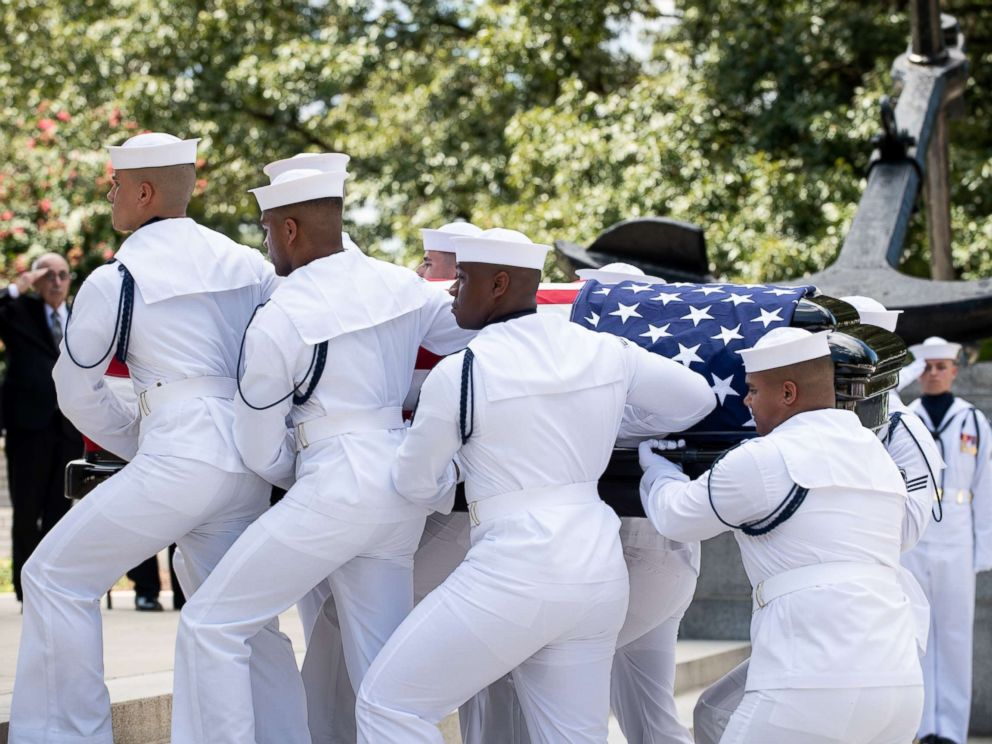 Navy Body Bearers move the casket of the late Sen. John McCain from his processional hearse to the United States Naval Academy Chapel, Sept. 2, 2018. John Sidney McCain, III graduated from the United States Naval Academy in 1958.