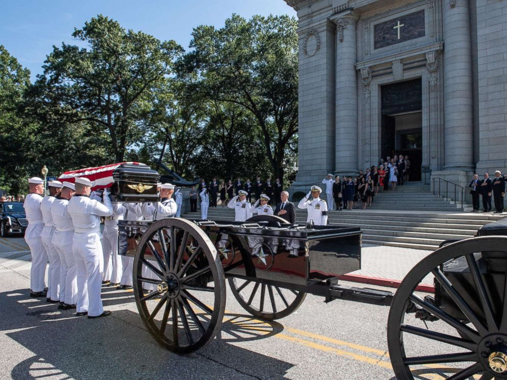 Navy Body Bearers place the casket of the late Sen. John McCain onto a horse-drawn caisson after his funeral service at the United States Naval Academy Chapel, Sept. 2, 2018. John Sidney McCain, III graduated from the United States Naval Academy in 1958.