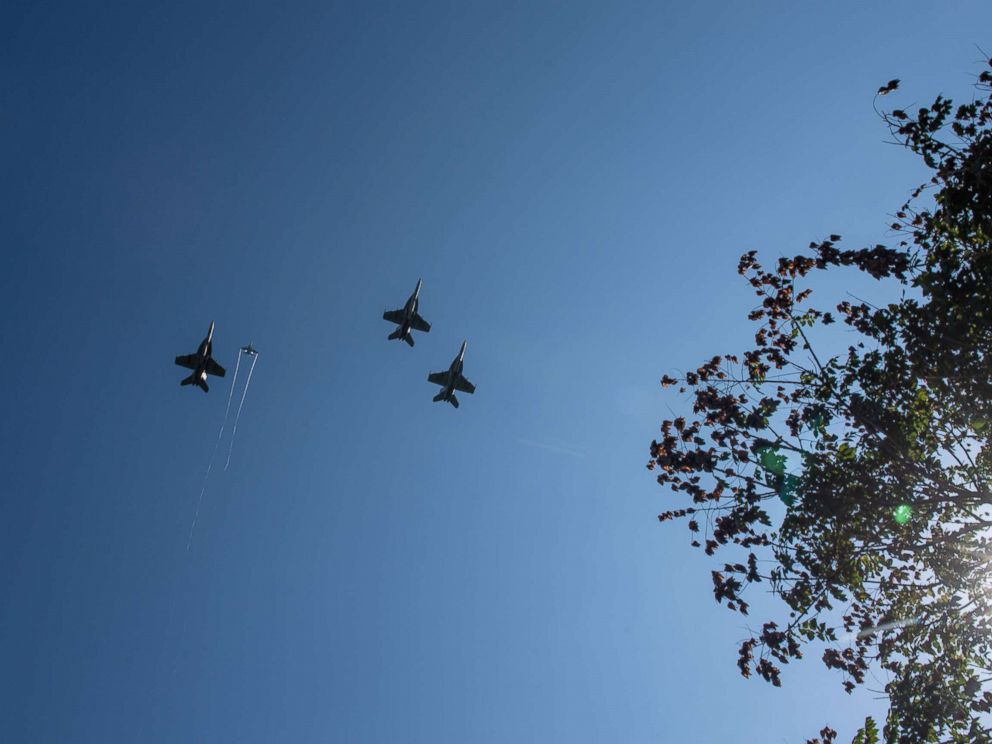 F/A-18 Super Hornets from Strike Fighter Squadrons (VFA) 31, VFA-32, VFA-87 and VFA-105 honor the late Sen. John McCain with a fly-over of the United States Naval Academy during his burial service, Sept. 2, 2018.