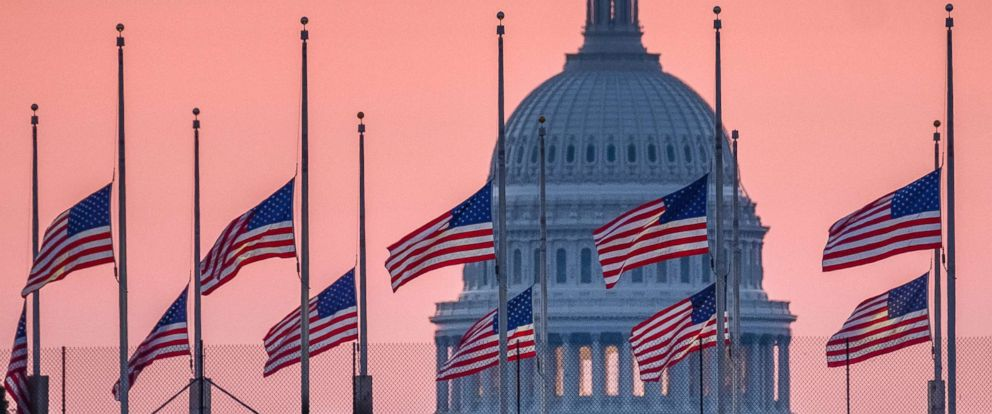 PHOTO: Flags flying a half-staff in honor of Sen. John McCain frame the U.S. Capital at daybreak in Washington, D.C., Aug. 26, 2018. McCain, 81, died at his ranch in Arizona after a yearlong battle with brain cancer.