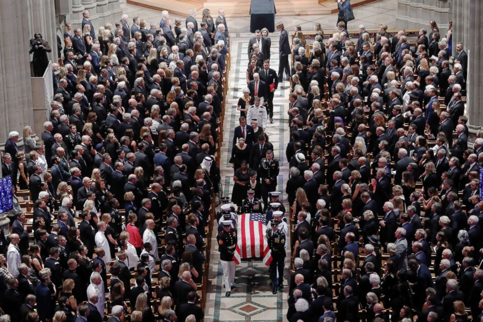 PHOTO: The family of Sen. John McCain follows as his casket is carried during the recessional at the end of a memorial service at Washington National Cathedral in Washington, Sept. 1, 2018.