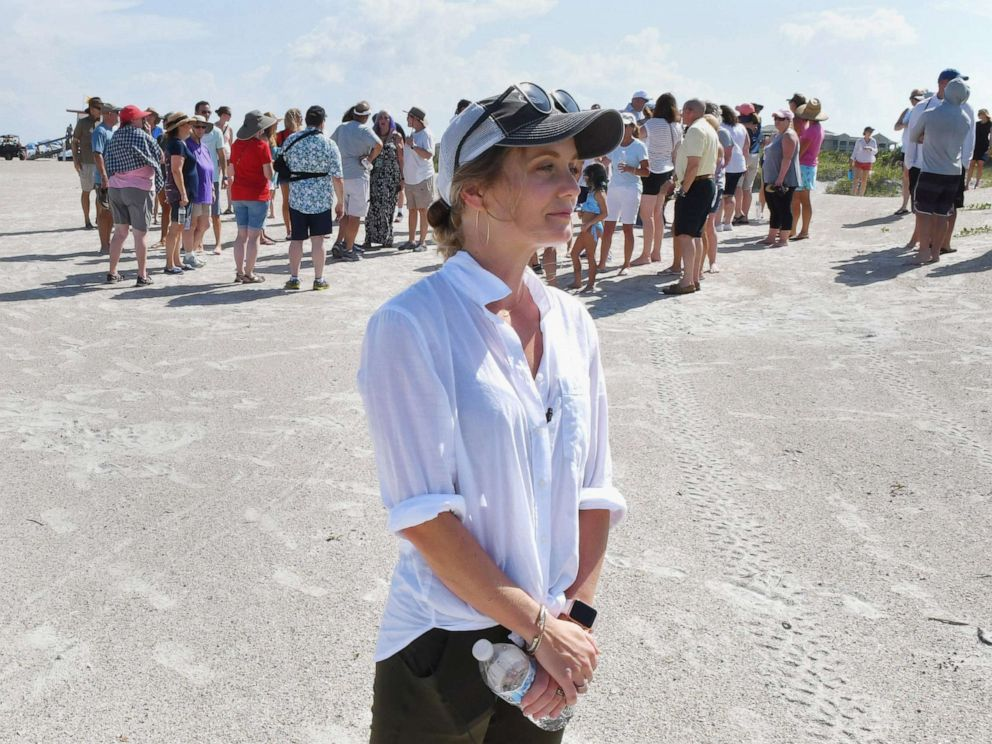 PHOTO: Stephanie Young McCluney, wife of Brian McCluney, one of two missing boaters, is joined by supporters at Jetty Park, Aug. 18, 2019, to pray and search the shore clues to the missing boaters who left Port Canaveral two days earlier.