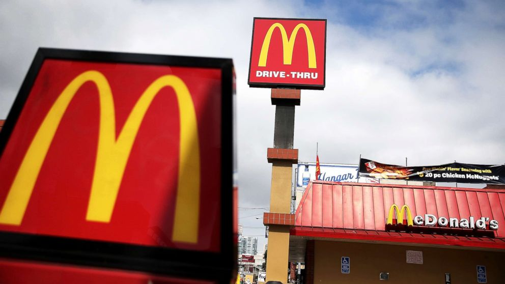 Signs are posted on the exterior of a McDonald's restaurant on April 22, 2015, in San Francisco.
