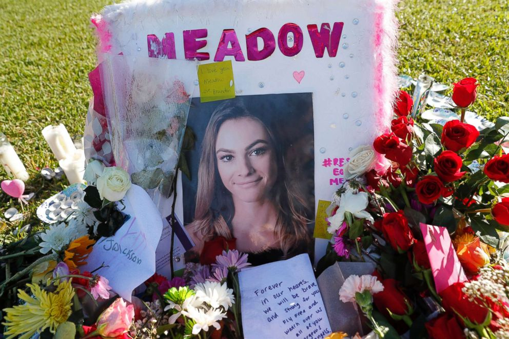 PHOTO: A photo of Meadow Pollack, one of the seventeen victims who was killed in the shooting at Marjory Stoneman Douglas High School, sits against a cross as part of a public memorial, in Parkland, Fla., Feb. 17, 2018.