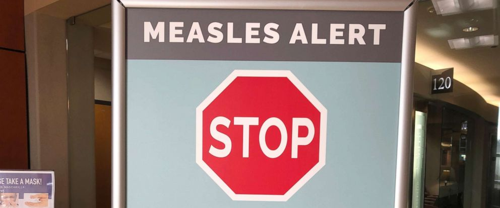 PHOTO: Signs are posted at The Vancouver Clinic in Vancouver, Wash., to warn patients and visitors of a measles outbreak, Jan. 30, 2019.