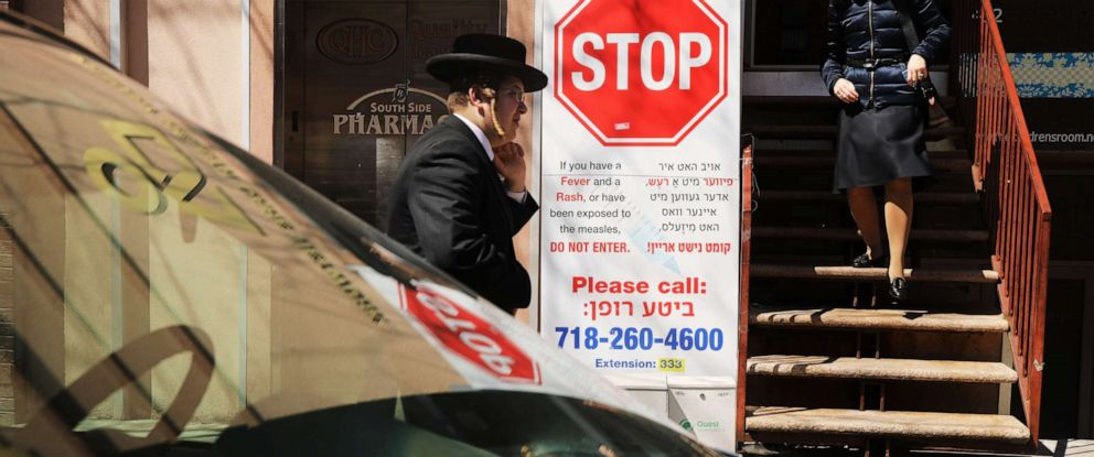 PHOTO: A sign warns people of measles in the ultra-Orthodox Jewish community in Williamsburg on April 10, 2019 in New York.