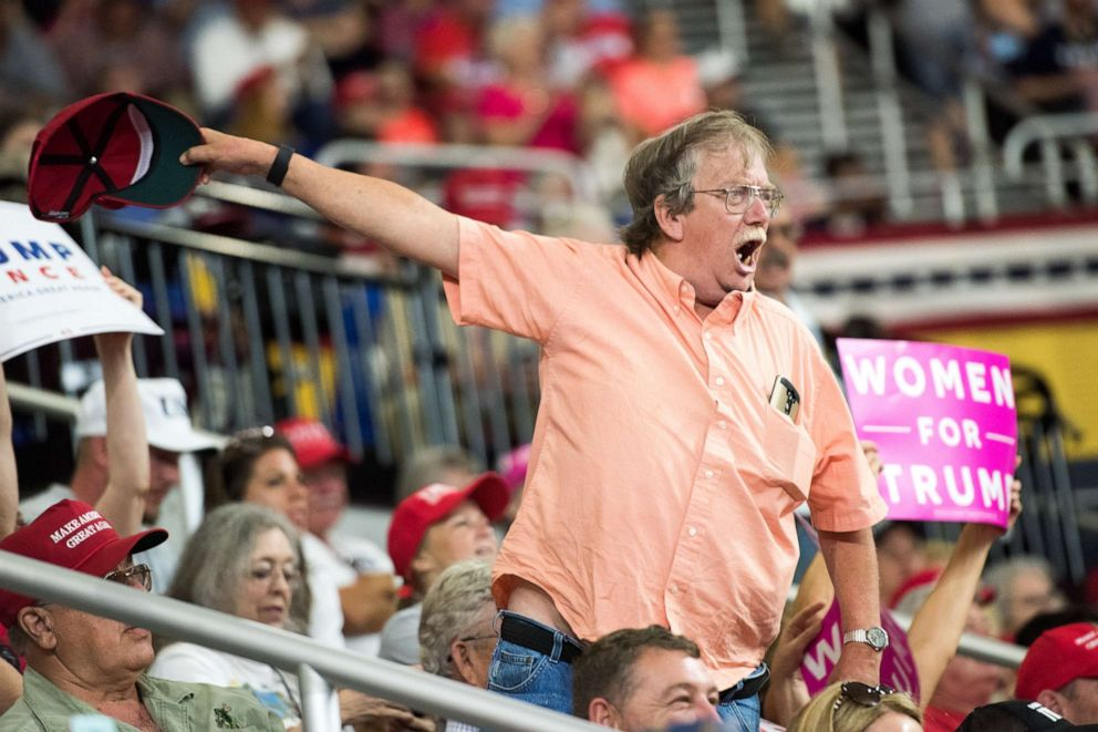PHOTO: A supporter of President Donald Trump shouts at members of the media during a campaign rally at Freedom Hall on Oct. 1, 2018, in Johnson City, Tenn.