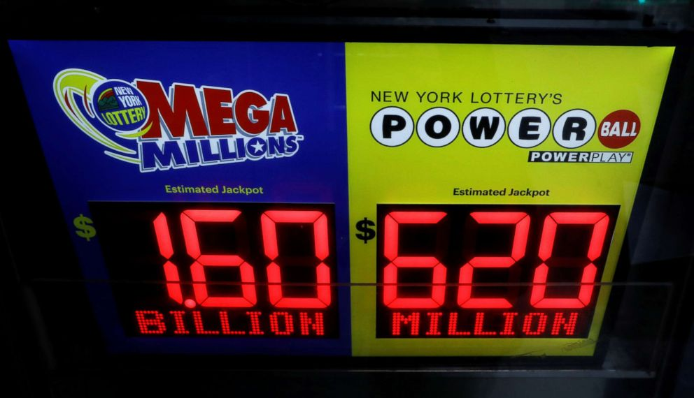 PHOTO: Signs display the jackpots for Tuesdays Mega Millions and Wednesdays Powerball lottery drawings in New York, Oct. 22, 2018.