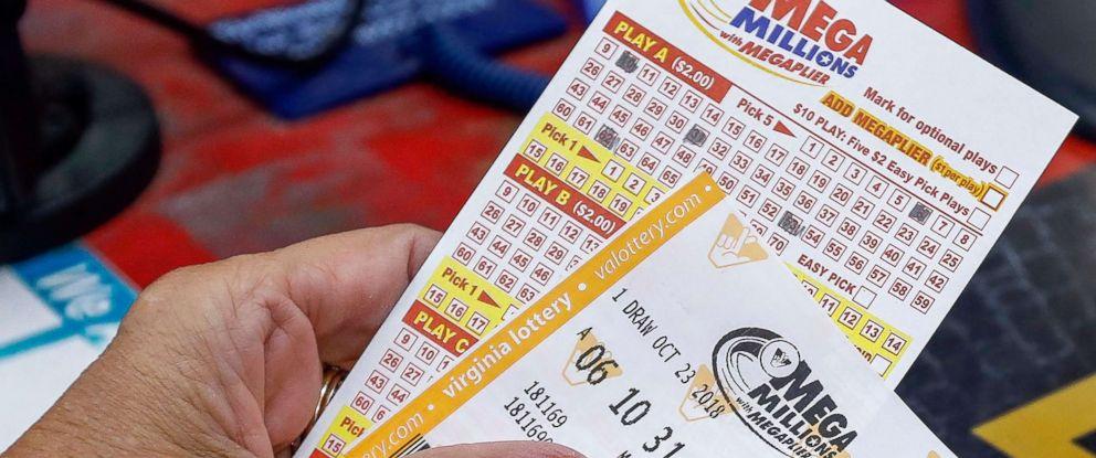 PHOTO: A customer purchases Mega Millions lottery tickets at a retailer in Arlington, Va., Oct. 22, 2018.