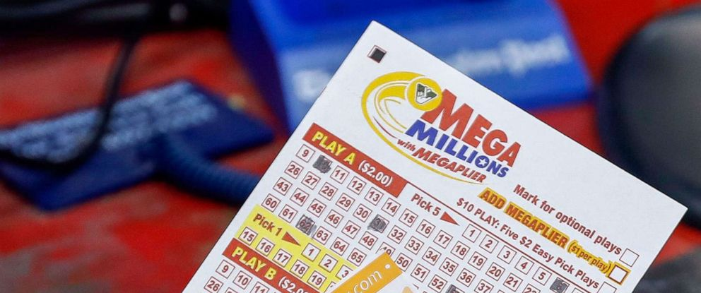 PHOTO: In this Oct. 22, 2018, file photo, a customer purchases Mega Millions lottery tickets at a retailer in Arlington, Virginia.