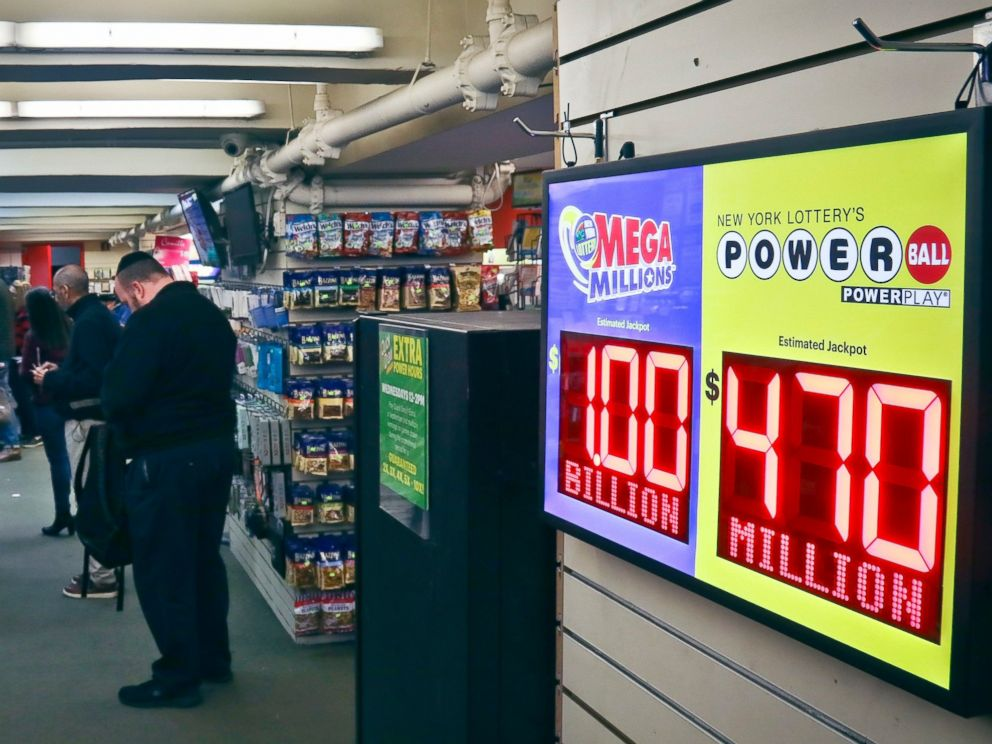 PHOTO: Lottery players buy Mega Millions lottery tickets, Friday Oct. 19, 2018, in New York. The estimated jackpot for Fridays drawing has soared to $1 billion.