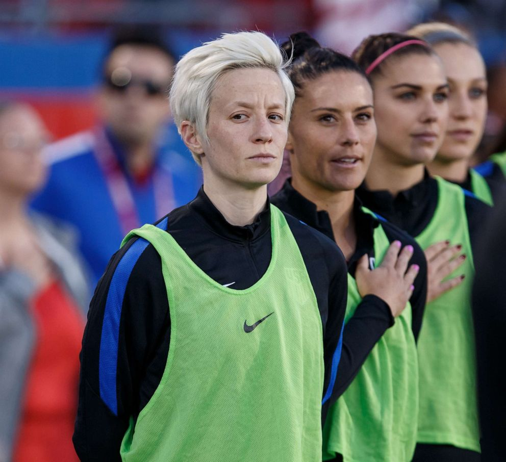 PHOTO:Megan Rapinoe and teammates stand during the national anthem during the International Friendly match between the USA and Russia on April 6, 2017, at Toyota Stadium in Frisco, Texas.