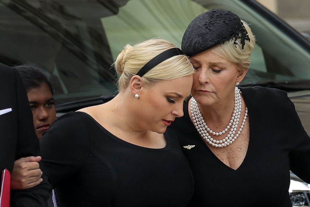 PHOTO: Meghan McCain and her mother Cindy McCain embrace as the casket of the late Sen. John McCain arrives at the Washington National Cathedral for the funeral service for McCain, on Sept. 1, 2018 in Washington, D.C.