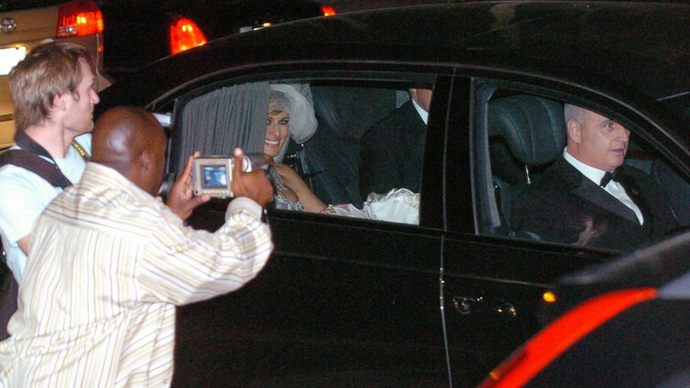 Photographers snap pictures as a beaming Melania Knauss and new husband Donald Trump  leave the Episcopal Church of Bethesda-by-the-Sea in Palm Beach, Fla., after their star-studded wedding ceremony, Jan. 22, 2005.