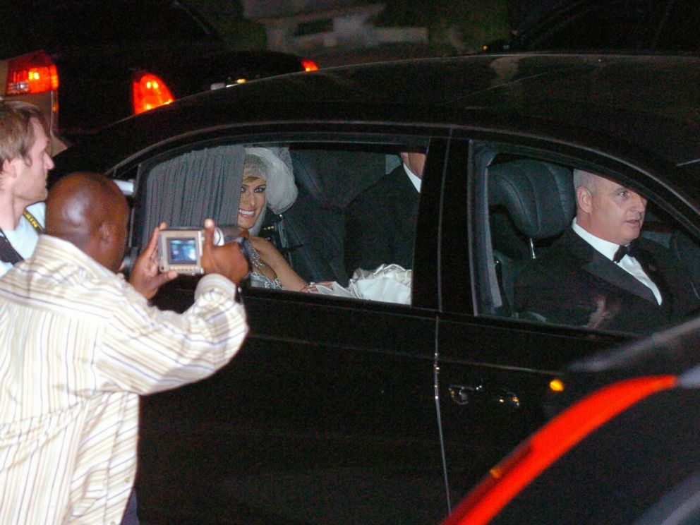 PHOTO: Photographers snap pictures as a beaming Melania Knauss and new husband Donald Trump leave the Episcopal Church of Bethesda-by-the-Sea in Palm Beach, Fla., after their star-studded wedding ceremony, Jan. 22, 2005.