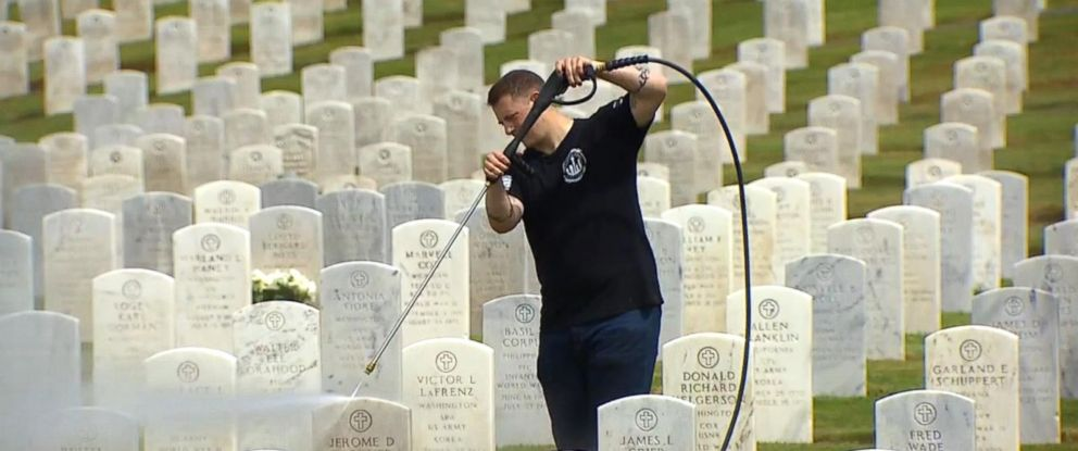 PHOTO: For weeks, Jordan Houghton and others from the American Legion Post 206 have been cleaning the headstones at the veterans section of the Evergreen Washelli Cemetery in Seattle.
