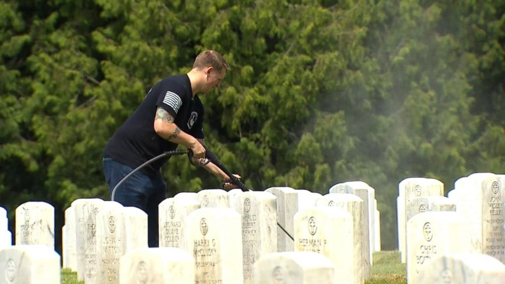 PHOTO: Jordan Houghton, whos spent hours working to shed the headstones of decades worth of dirt and grime, said that every person buried in the cemetery has a story.
