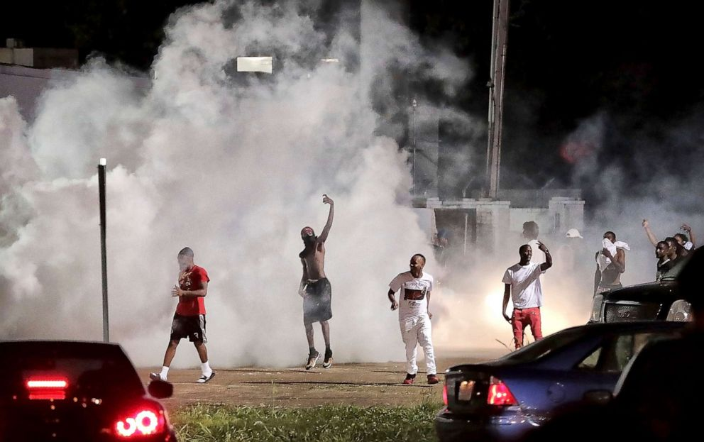 PHOTO: Frayser community residents taunt authorities as protesters take to the streets in anger against the shooting of a youth identified by family members as Brandon Webber by U.S., June 12, 2019, in Memphis, Tenn.