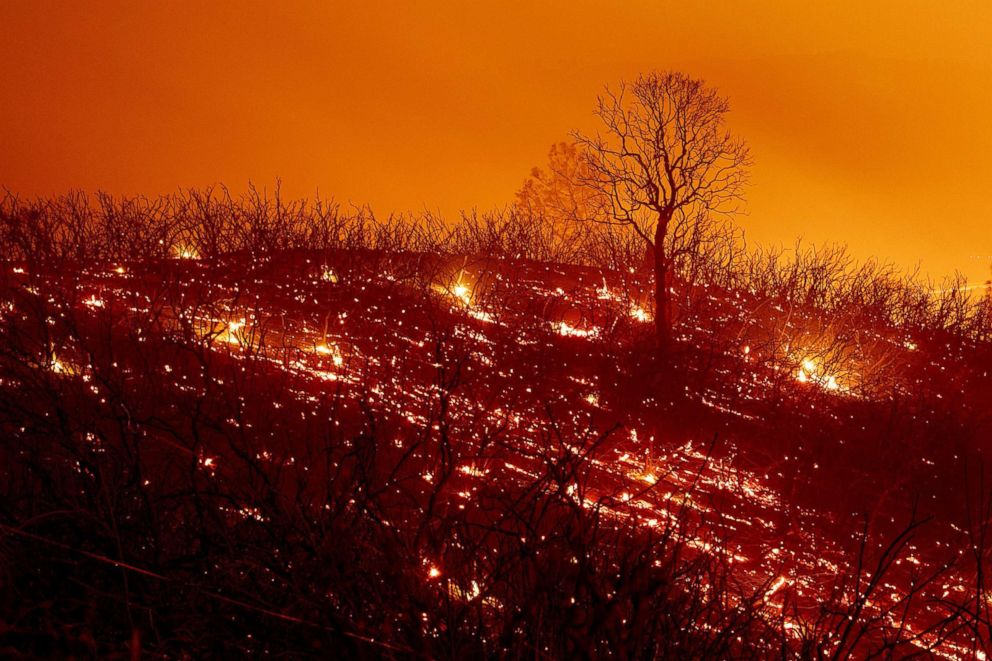 PHOTO: Embers smolder along a hillside after the Ranch Fire, part of the Mendocino Complex Fire, burned though the area near Clearlake Oaks, Calif., Aug. 5, 2018.