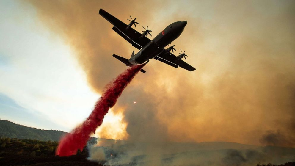 An air tanker drops retardant on the Ranch Fire, part of the Mendocino Complex Fire, burning along High Valley Rd near Clearlake Oaks, California, Aug. 5, 2018. <br><br>Several thousand people have been evacuated as various fires swept across the state.