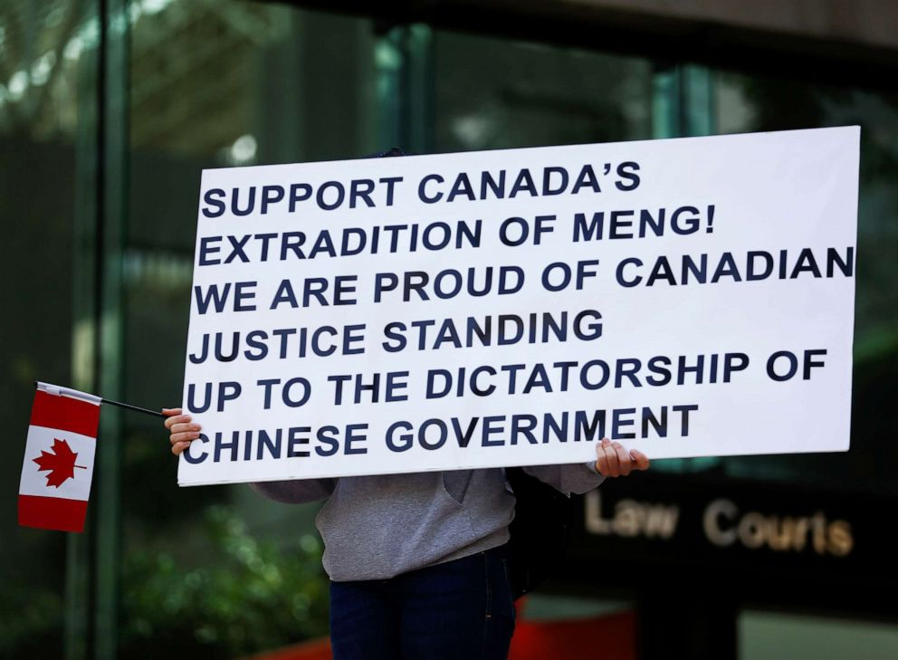 PHOTO: A person holds a sign supporting the extradition of Huaweis Financial Chief Meng Wanzhou outside of British Columbia Supreme Court building in Vancouver, Canada, May 8, 2019.