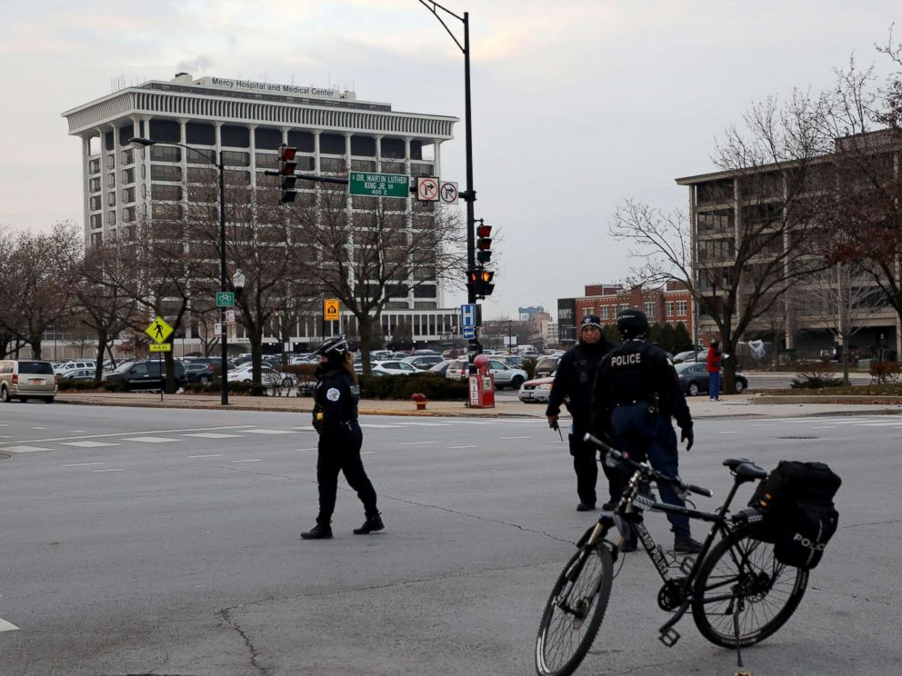 PHOTO: Police stand near Mercy Hospital, Nov. 19, 2018, after multiple people were reported shot on the Near South Side of Chicago.