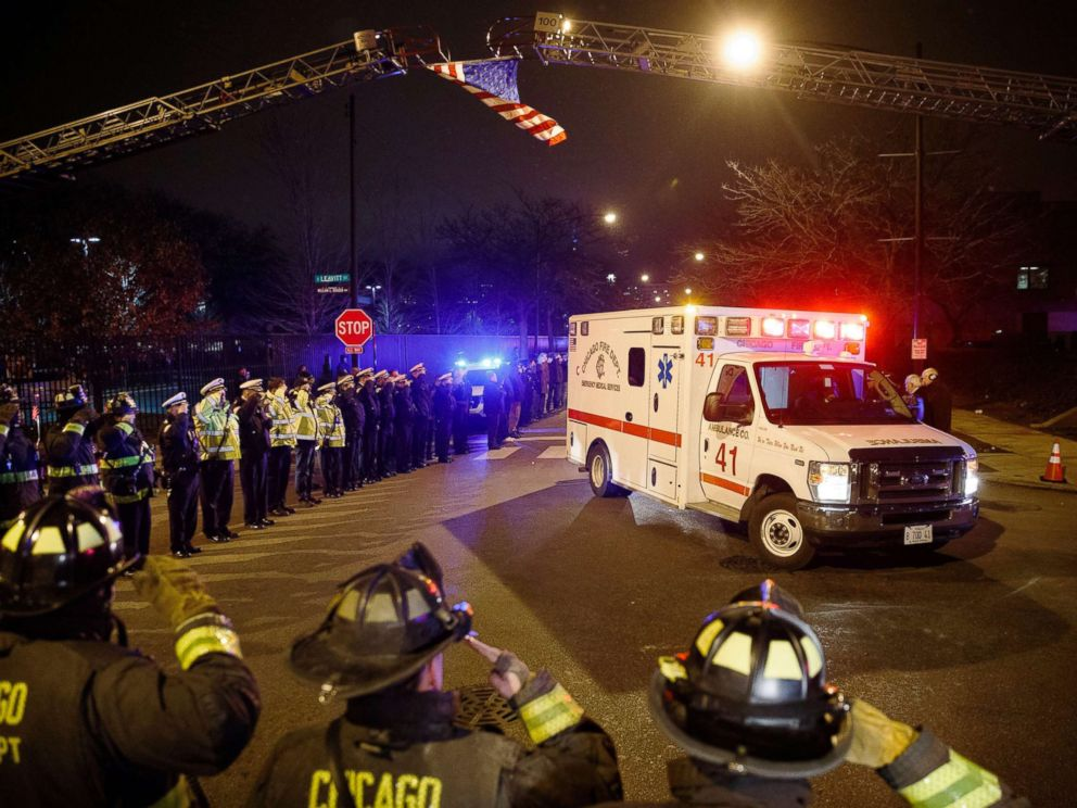 PHOTO: Police and firefighters salute as an ambulance arrives at the medical examiners office carrying the body of Chicago Police Department Officer Samuel Jimenez, who was killed during a shooting at Mercy Hospital, Nov. 19, 2018, in Chicago.