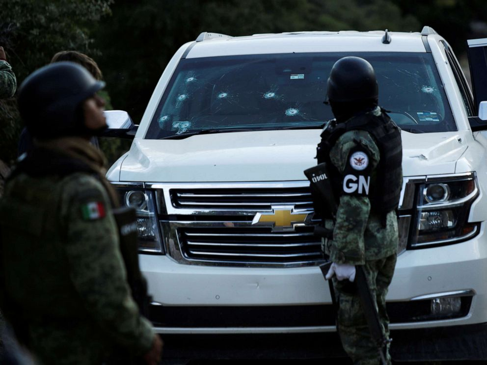 PHOTO: Soldiers assigned to Mexicos National Guard stand by a bullet-riddled vehicle belonging to one of the Mexican-American Mormon families that were killed by unknown assailants, in Bavispe, Sonora state, Mexico, Nov. 5, 2019.