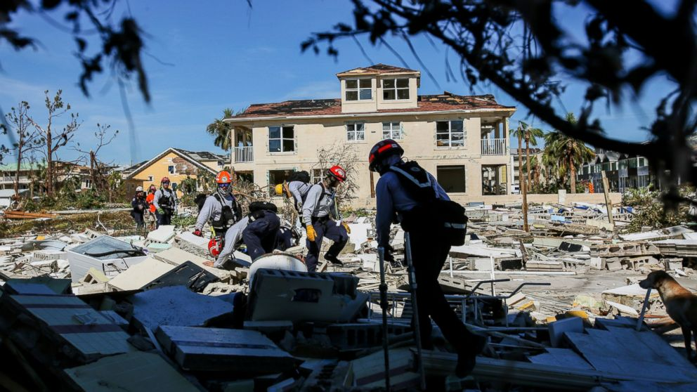 Members from South Florida Task Force search a flattened home destroyed by Hurricane Michael in Mexico Beach, Fla., Friday, Oct. 12, 2018, after Hurricane Michael went through the area on Wednesday.