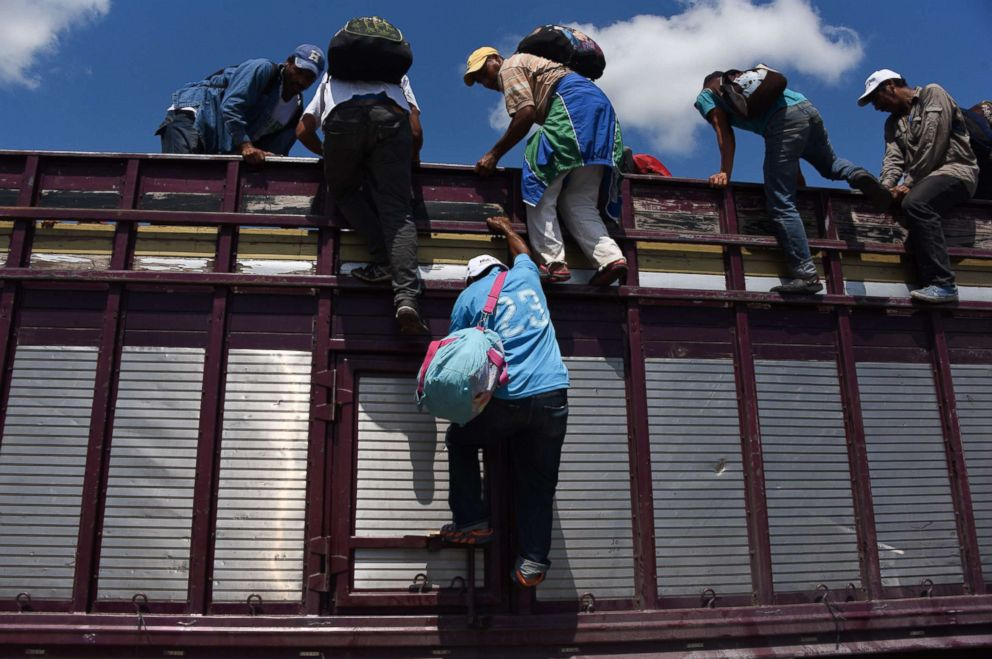 Honduran migrants heading in a caravan to the U.S., climb on a truck in Tapachula, Chiapas state, Mexico, Oct. 22, 2018.