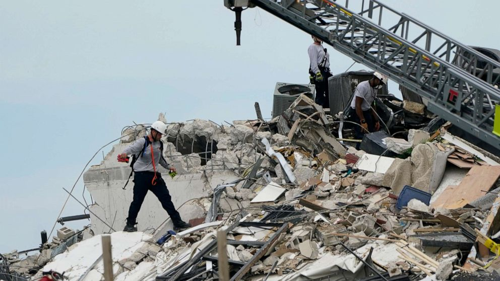 PHOTO: Rescue worker walk among the rubble where a wing of a 12-story beachfront condo building collapsed, June 24, 2021, Surfside, Fla.