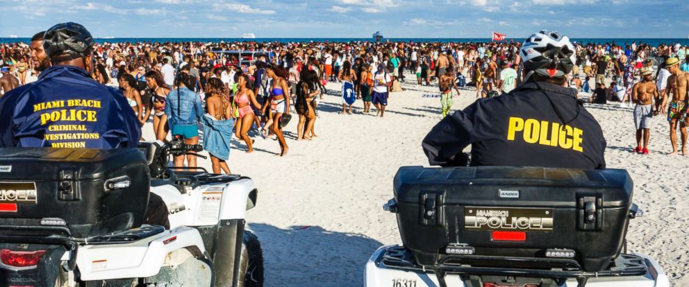 PHOTO: Miami Beach Police watching the crowds during Spring Break, March 17, 2017.