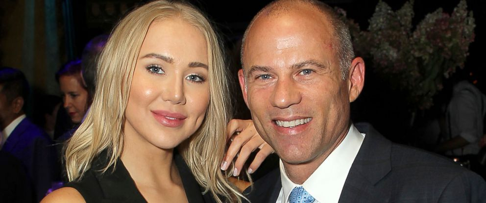 PHOTO: Attorney Michael Avenatti poses with Mareli Miniutti for a photo at a party in New York in September 2018.