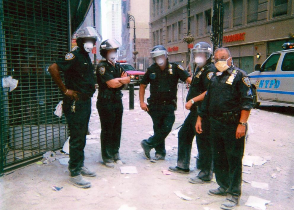 PHOTO: NYPD Sergeant Michael Guedes, far right, stands with a group of officers wearing face masks in Manhattan after the September 11 attack in 2001.