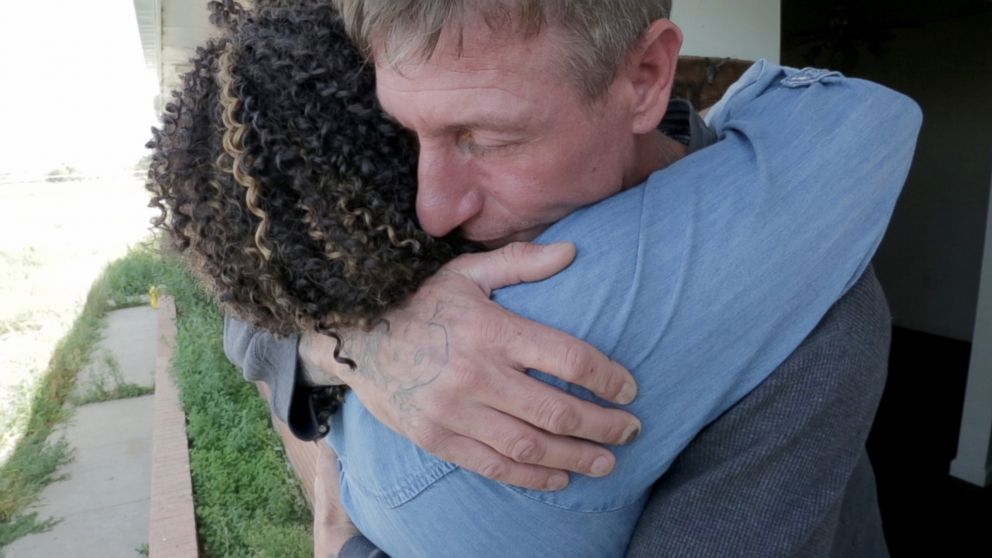 Former skinhead Michael Kent gives his former parole officer Tiffany Whittier a hug after she surprises him at his home.