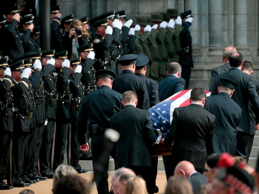 PHOTO: Pallbearers carry the casket of North County Cooperative Officer Michael Langsdorf inside the Cathedral Basilica of St. Louis for his funeral Mass on July 1, 2019.