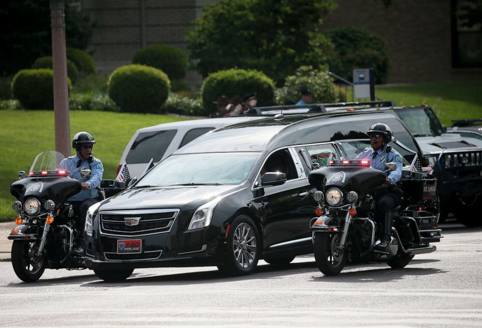 PHOTO: A motorcycle unit escorts the hearse carrying the casket of North County Cooperative Police Officer Michael Langsdorf to his funeral mass at the Cathedral Basilica of St. Louis on July 1, 2019, in St. Louis.