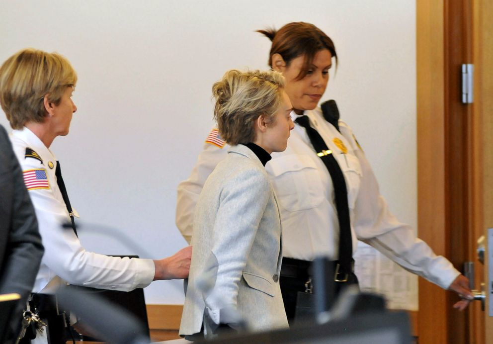 PHOTO: Michelle Carter, center, is led away by court officers after a hearing on her prison sentence in Taunton District Court in Taunton, Mass., Feb. 11, 2019.