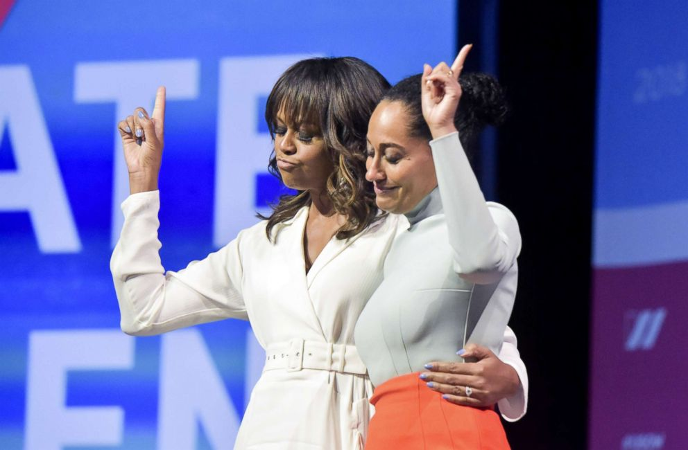 Former first lady Michelle Obama and actress Tracee Ellis Ross have a conversation on stage at The United State of Women Summit 2018 , May 5, 2018, in Los Angeles.