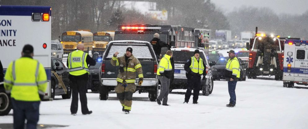 PHOTO: Emergency personnel work the scene of a multi-vehicle pileup on Interstate 94 in southern Michigan, March 9, 2018.