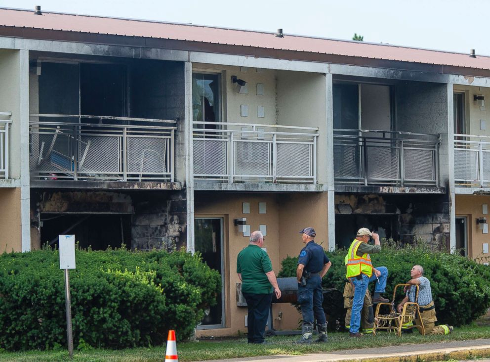PHOTO: Officials investigate a fire at the Cosmo Extended Stay Motel in Sodus Township, Mich., July 28, 2018.