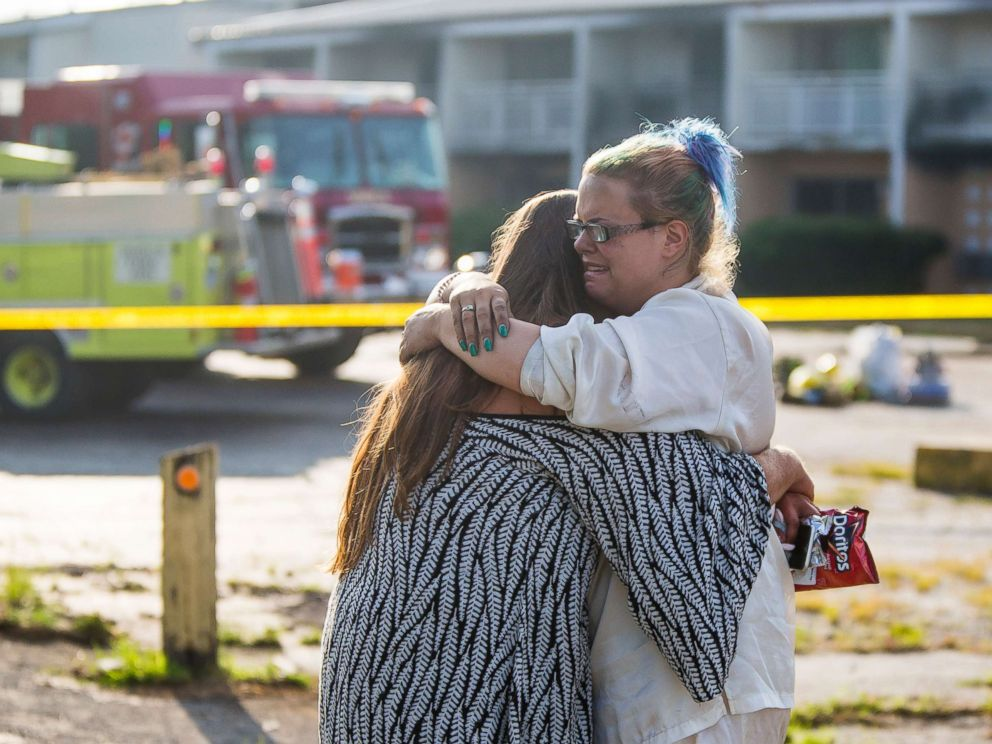 PHOTO: Hotel residents Cassundra Clements, left, and Sarah Sanders comfort one another after a fire at the Cosmo Extended Stay Motel in Sodus Township, Mich., July 28, 2018.